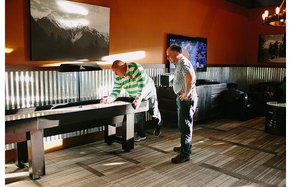 Men playing Shuffle Board