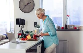 Woman watching cooking demo through her computer