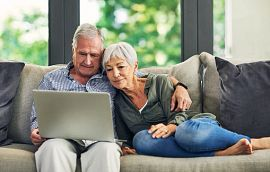 Couple on Couch viewing Laptop