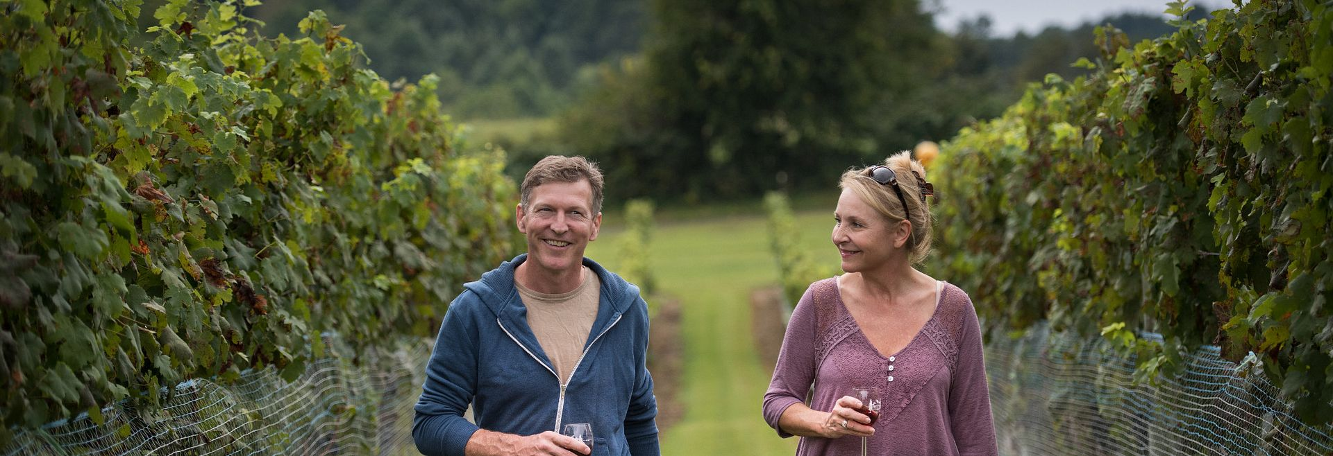 Couple walking in the vineyards