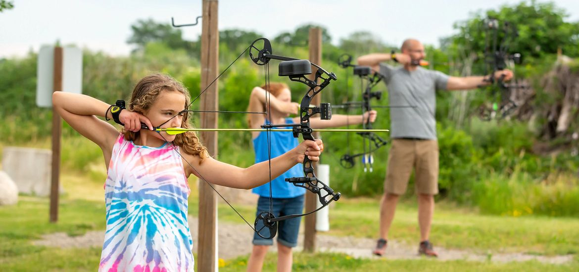 Archery Dad Daughters Bow and Arrow Getty Images