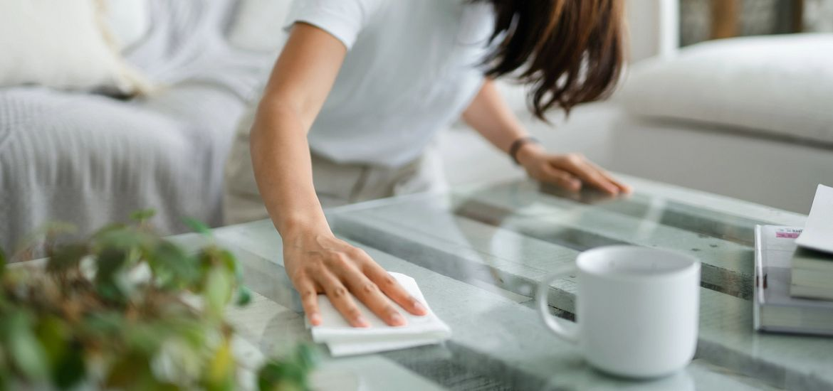 Woman Cleaning Table Getty Images