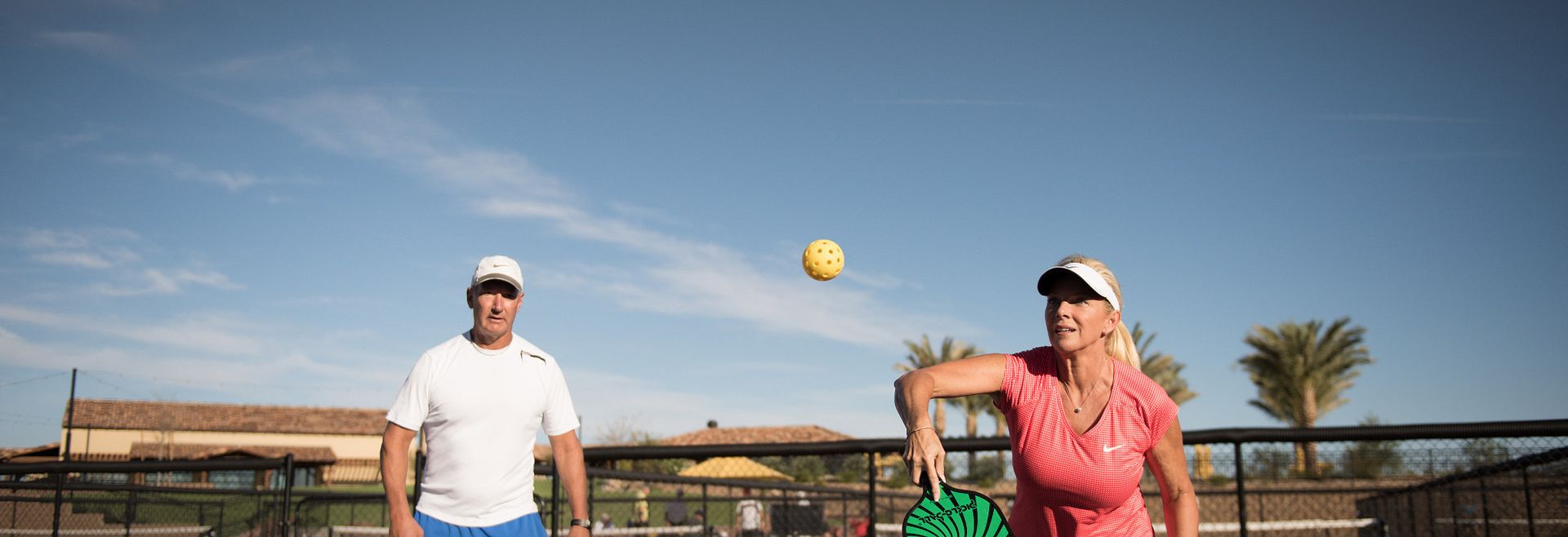 woman and man playing pickleball