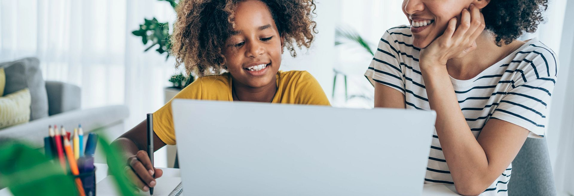 Mother Daughter Studying Online Getty Images