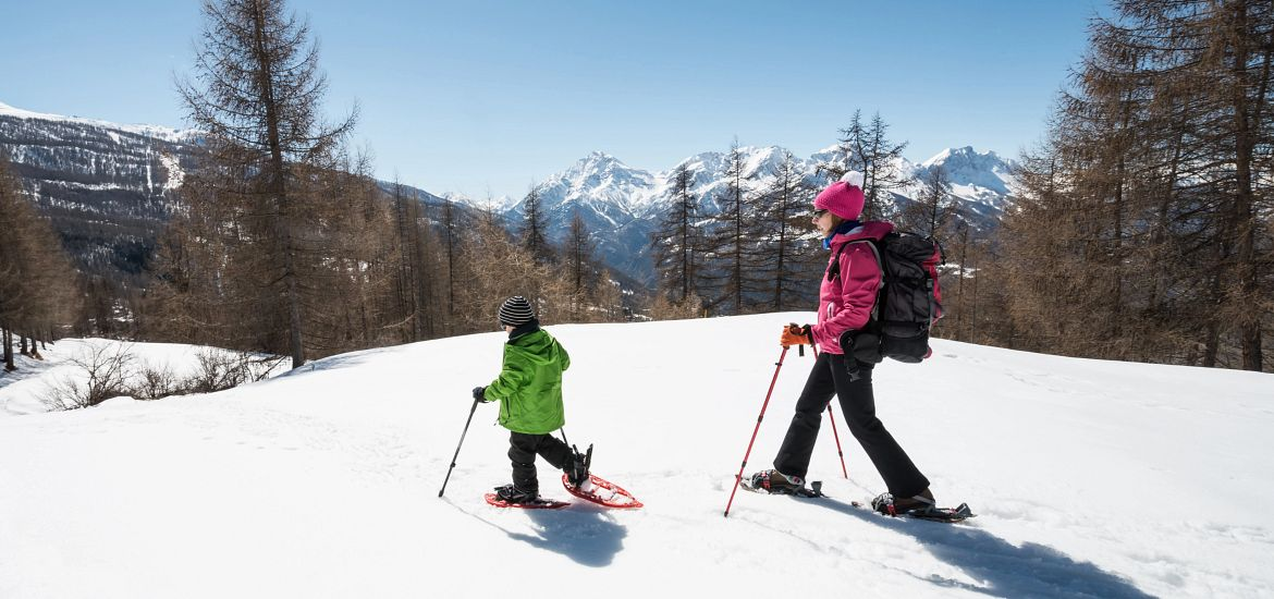 Son Mother Snow Shoeing Colorado Mountains Getty Images