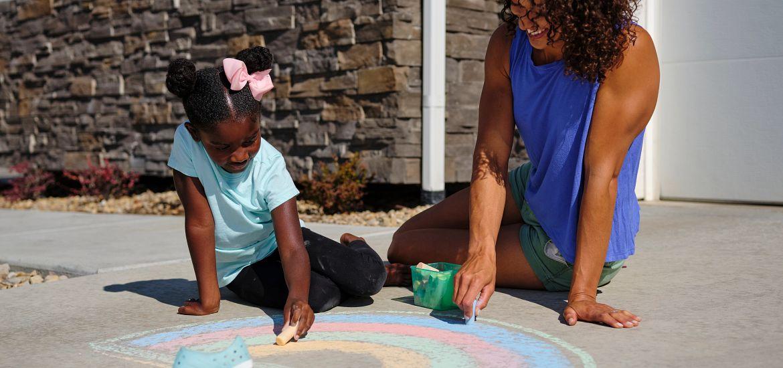 Mom Daughter Sidewalk Chalk Getty Images
