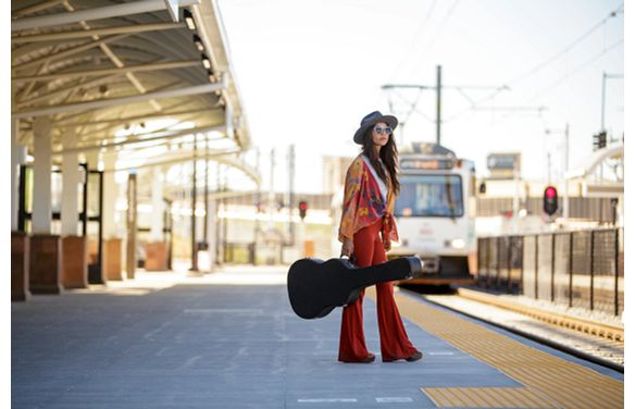 Lyric Woman Guitar RTD Light Rail Station