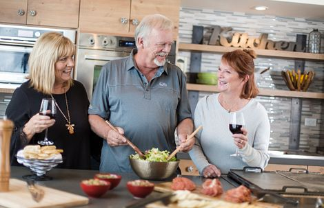 Man and 2 women cooking together in the kitchen