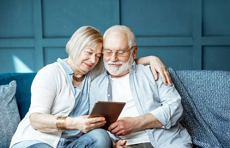 Couple on the couch with a tablet