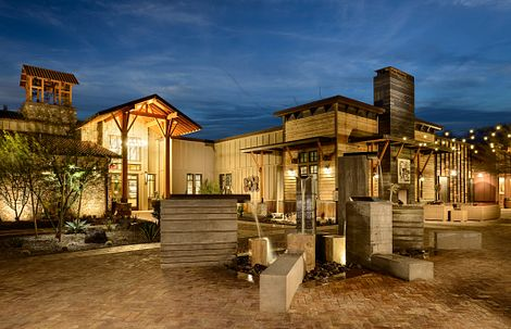 Exterior of the Club at night at Trilogy Wickenburg Ranch in Arizona