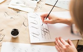 Woman Hand Lettering Pen Ink Paper Getty Images