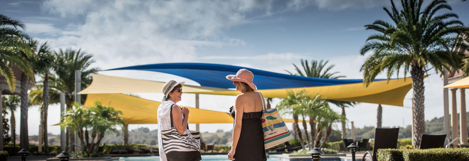 Ladies walking by the Resort Pool