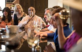 Group in Culinary Studio Drinking Wine