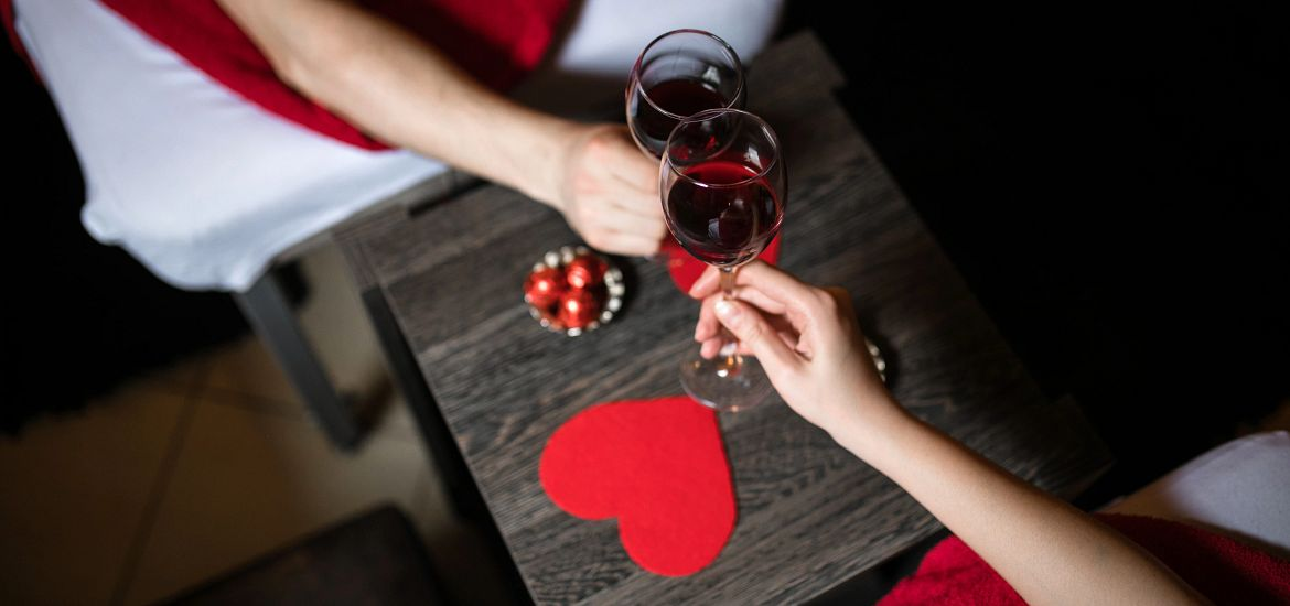 Couples Toasting Red Wine Valentine's Day Getty Images