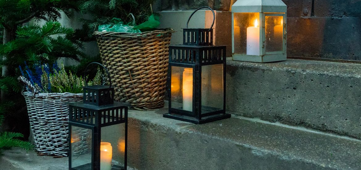 Three lanterns on front steps of home