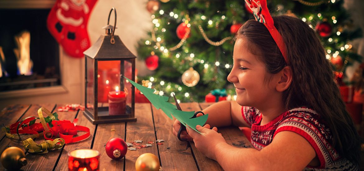Young Girl handcrafted Holiday Cards Getty Images