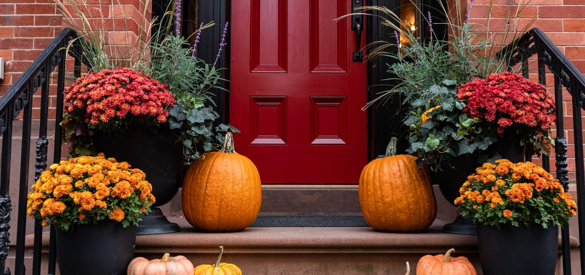 Colorful pumpkins flowers front porch stairs