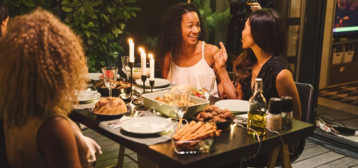 Women Dinner Party House Patio Getty Images