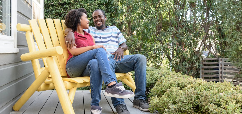 Yellow Bench Gray Porch Couple