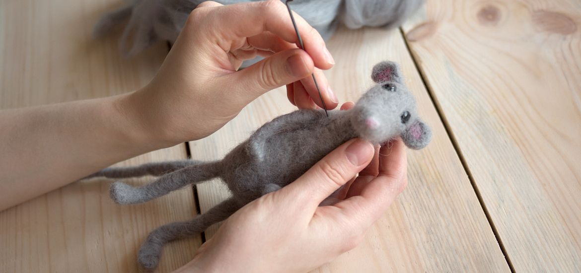 Womans Hands Needle Felting Mouse Getty Images