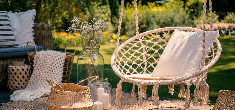 Beige String Swing Wicker Baskets Wooden Deck Garden Getty Images